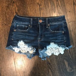 American Eagle jean shorts with lace pockets